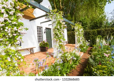 Garden landscape with flowerbed and entrance area
