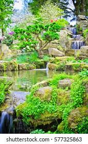 Garden landscape of waterfall on spring