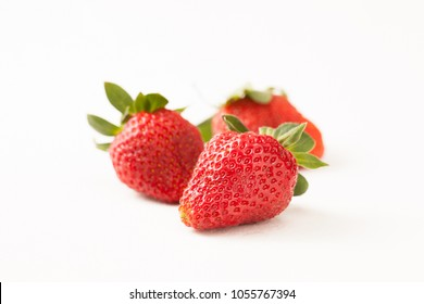 Garden large fresh strawberries on white concrete background. Copy space. Healthy diet.
