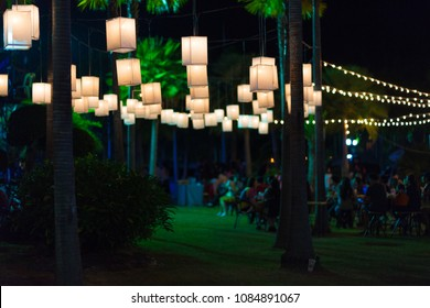 Garden Lighting. outdoor string lights hanging on a line in backyard.