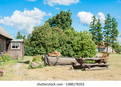 A garden with an old boat at Saaremaa