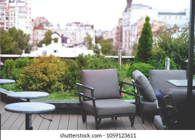 Garden on the roof. Modern terrace design with sofa. Home interior of living room. Green terrace on the roof of the house. Rooftop of penthouse.