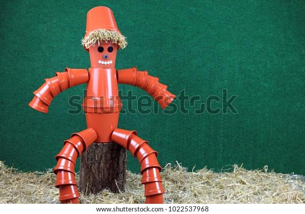 Garden Ornament Of A Flower Pot Man Made From Terracotta Style Pots Sat On A Wooden & Garden Ornament Flower Pot Man Made Stock Photo (Edit Now) 1022537968