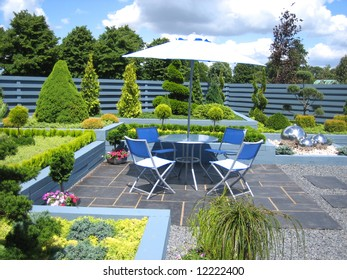 Garden with outdoor seating and green plants