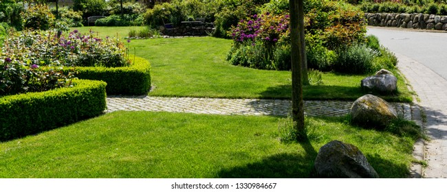 Garden path to the street with lawn
