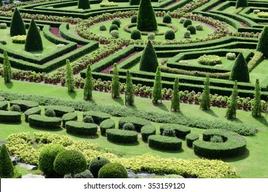 Garden path with topiary landscape background