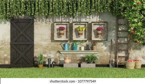 Garden with potted flowers framed by wooden frames