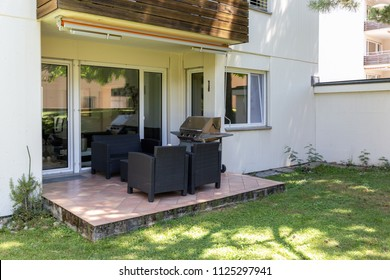 Garden with private patio and outdoor furniture. Nobody inside