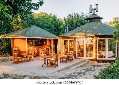 Garden restaurant with morning light in Cirali, Turkey.