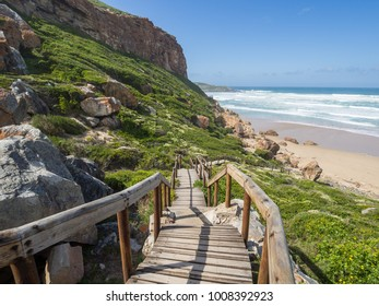 Garden Route - Robberg Nature Reserve - Wooden walkway leading down to beautiful beach and ocean on Robberg Island