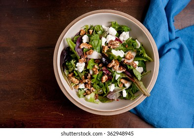 garden salad with arugula, goat cheese and roasted walnuts and a healthy vinaigrette