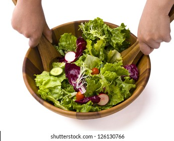 A garden salad being tossed on a white background.