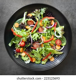 Garden salad in black bowl.  Overhead view.