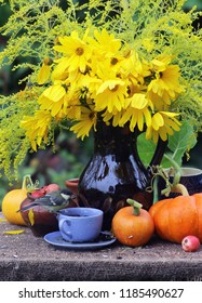 garden scene with a bouquet of sunflowers, pumpkins and a cup of coffee, gardening and floriculture theme