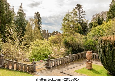 Garden Scenery with Old Victorian Monument in Belvedere Estate, County Westmeath, Ireland.