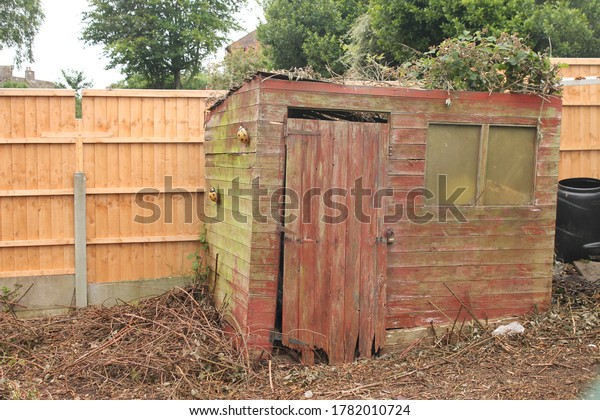 Garden shed in a state of disrepair
