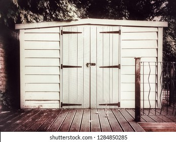 A garden shed in warm monochrome with a strong vignette