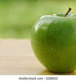 garden shot of a freshly picked apple