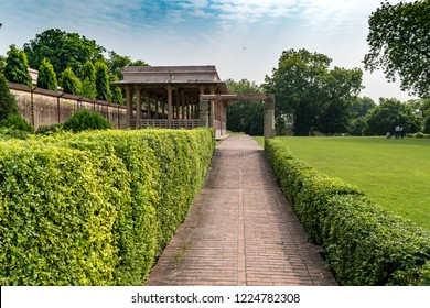 The Garden with sitting place at Dhamek Stupa, massive stupa located at Sarnath, 13 km away from Varanasi in the state of Uttar Pradesh, India. Stupas originated as pre-Buddhist tumuli