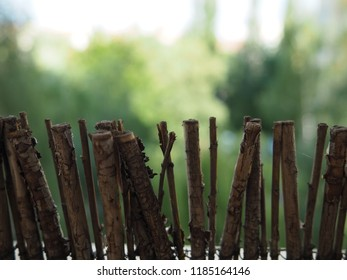 Garden small decoration wooden brown fence. Garden background, spring spirit, terrace and balcony roof.