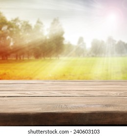garden spring background with desk wood and sunset