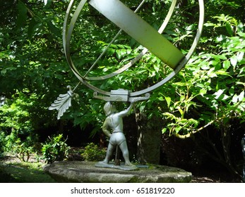 Garden statue in West Sussex, England, United Kingdom.