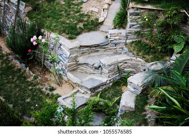 a garden stone path with stone wall