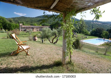 The garden and the swimming-pool of a luxury country house in the famous tuscan hills, Italy.