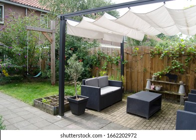 Garden with terrace and swing