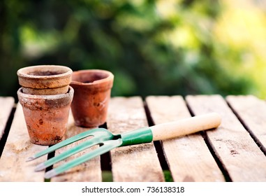 Garden tool and flower pots in the garden.