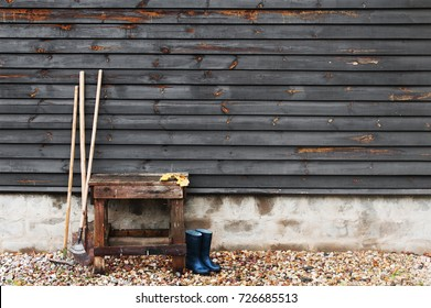 Garden tools by the wooden wall