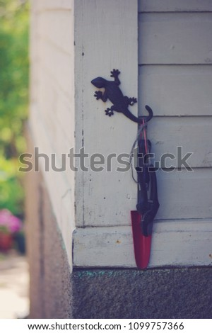 Garden Tools Hanging From Lizard Hook