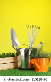 garden tools on lawn on bright colorful background close-up