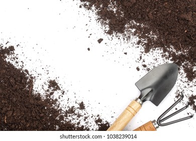 garden tools in soil isolated on white background with copy space for your text. Top view