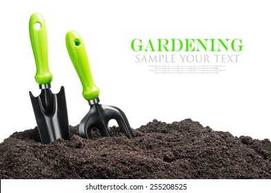 garden tools in soil isolated on white background. The text is an example and can be easily removed