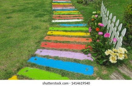 In the garden with a variety of colorful wooden walkways.