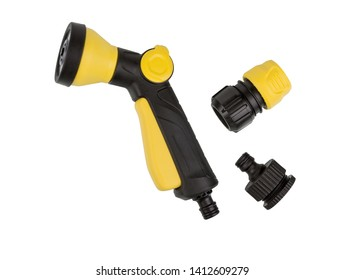 Garden water hose nozzle plus set of fittings, connectors isolated on white background. Yellow garden spray nozzle for garden hose close-up.