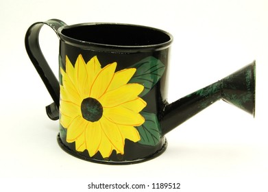 A garden watering can on a white background