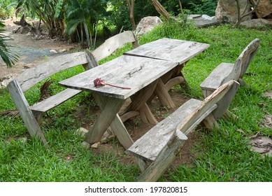 Garden wooden bench in garden