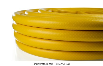Garden yellow hose in a skein. Isolated on a white background.