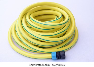 Garden yellow plastic hose-pipe with coupling