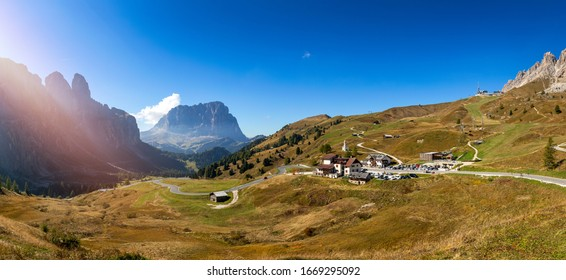 Gardena Pass, Trentino Alto Adige, Italy. Gardena Pass with Sassolungo mountain on the background. Passo Gardena, alpine pass between Val Badia and Val Gardena, South Tyrol, Italy.