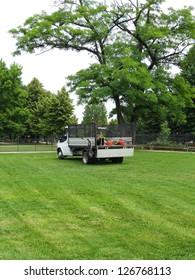 Gardener's truck and equipment on freshly cut grass
