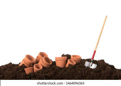 Gardening with black earth flower pots and shovel