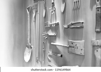 Gardening Equipment and craftsman tools hanging decorate on white wall. Flat lay concept