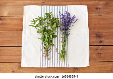 gardening, ethnoscience and organic concept - bunches of greens, spices or medicinal herbs on kitchen towel