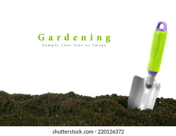 Gardening. The garden tool on the earth.