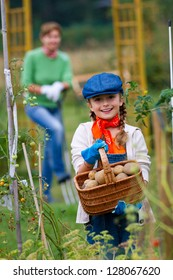 Gardening, gardener, child - lovely girl working in vegetable garden