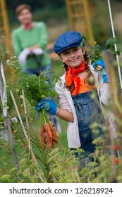 Gardening, gardener, kid - lovely girl working in vegetable garden