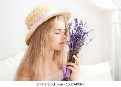gardening and people concept happy young woman smelling lavender flowers. Cute little Girl holds a bouquet of lavender. Lifestyle concept. Aromatherapy Wildflowers. Summer flower. childhood. provence